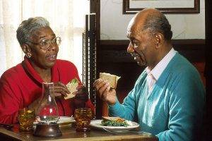 Elderly couple having lunch