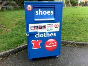 blue shoes and clothes donation bin